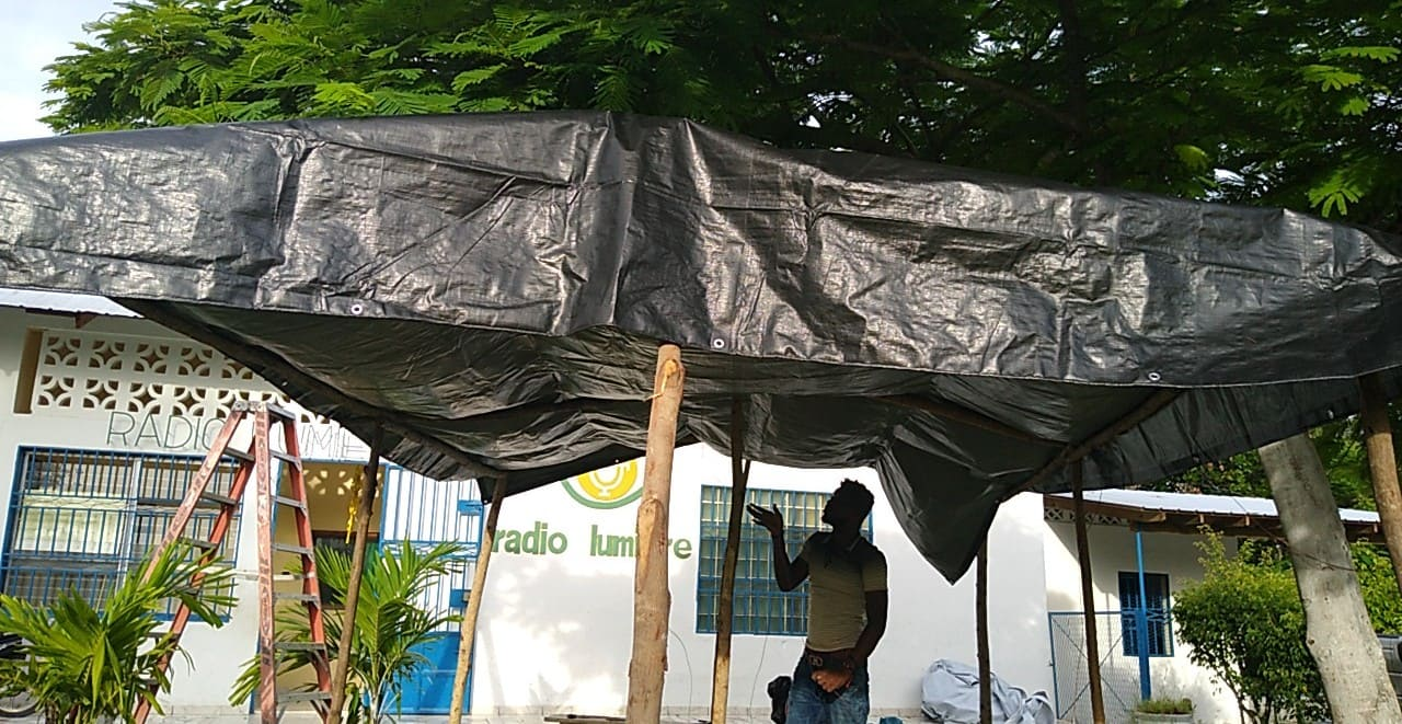 Setting up tarp outside of Cite Lumiere station
